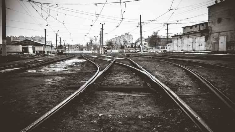 black and white city electric train electrical wires
